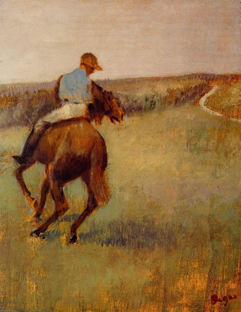 jockey-in-blue-on-a-chestnut-horse