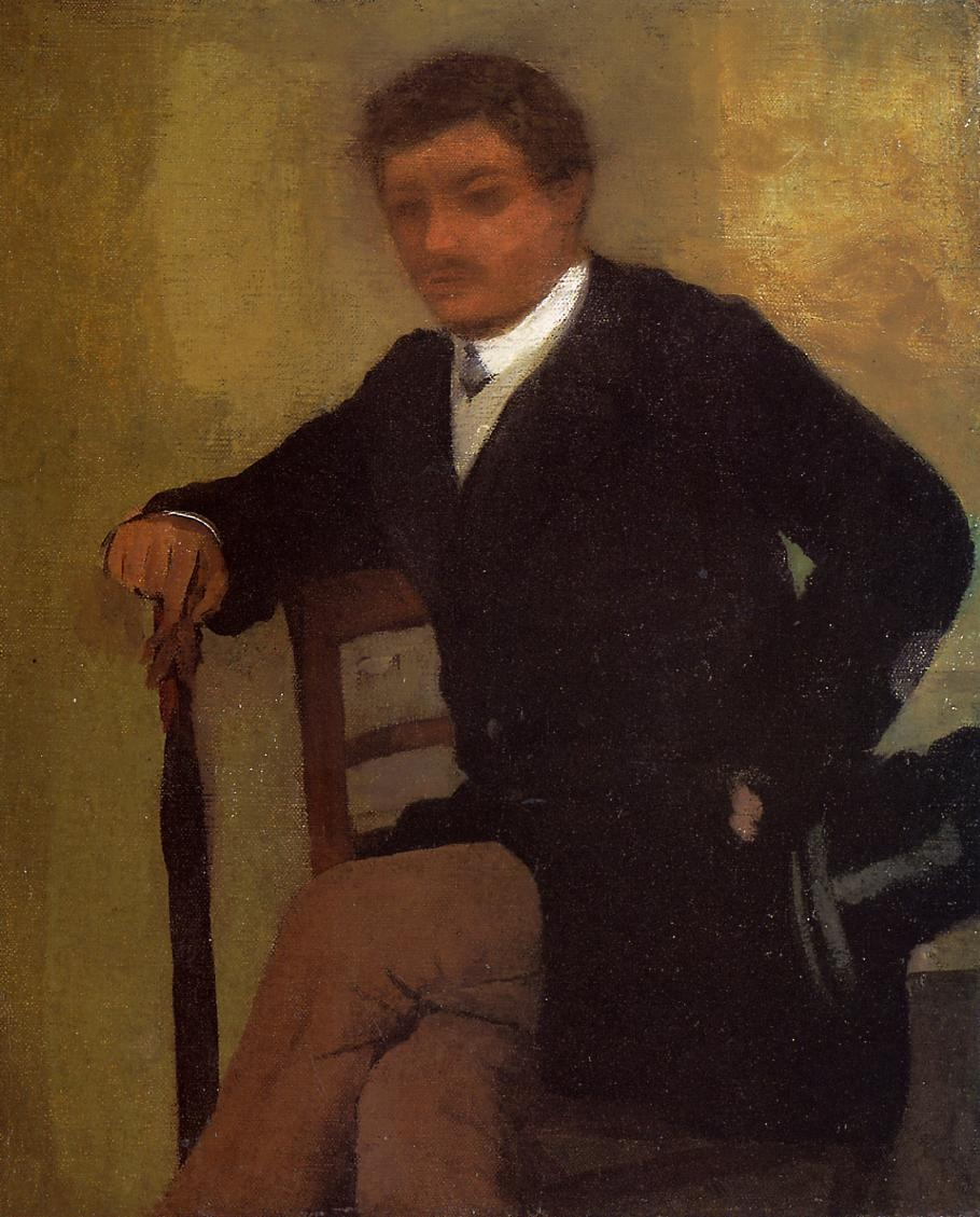 seated-young-man-in-a-jacket-with-an-umbrella