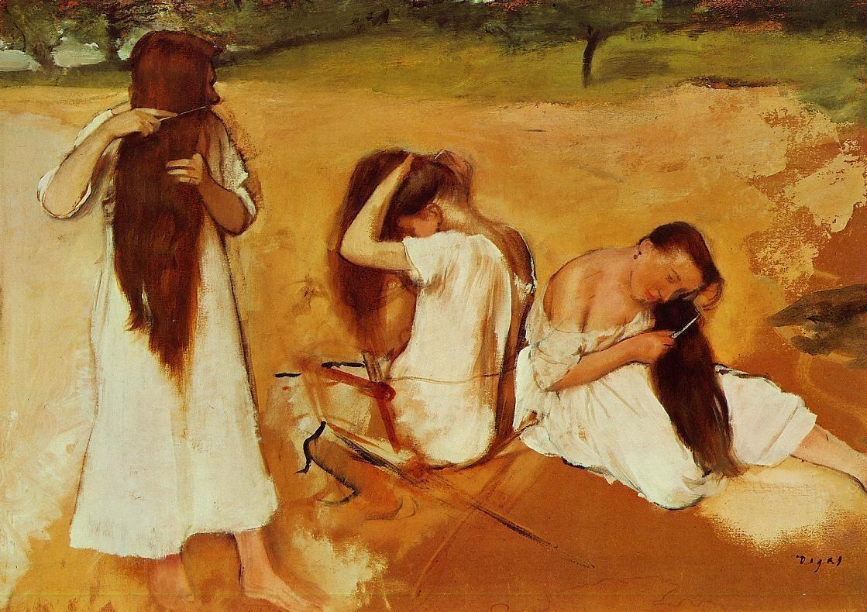 three-women-combing-their-hair
