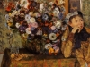 a-woman-seated-beside-a-vase-of-flowers