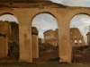 rome-the-colosseum-seen-through-arches-of-the-basilica-of
