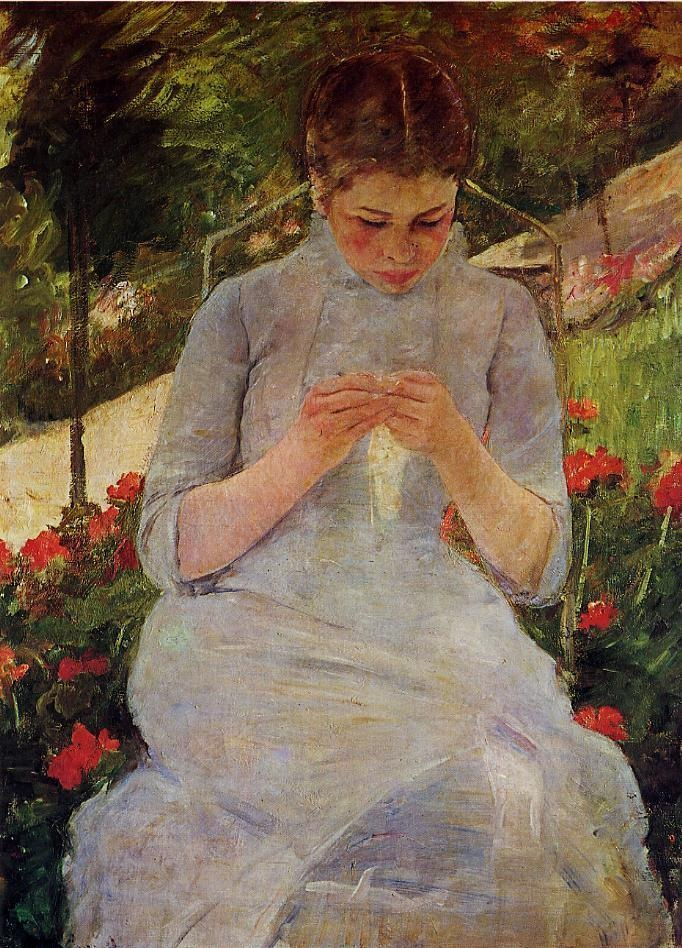 young-woman-sewing-in-a-garden